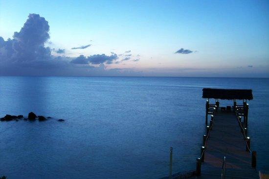 Compass Point Beach Resort: The pier at sunset