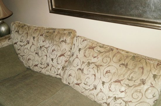 Jockey Club: soiled/stained couch