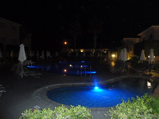 The King Jason Paphos: The main & baby pool at night