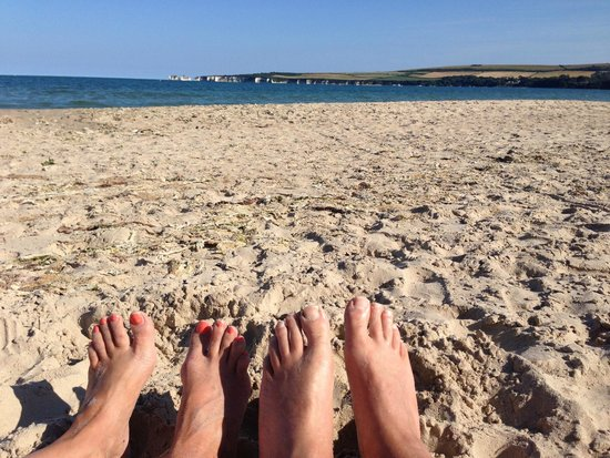 Studland beach and Nature Reserve: Enjoying Studland beach and view of Old Harry rocks