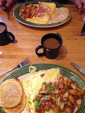 Applebee's : Mexican style omelette (bottom), ham and cheese style omelette (top), served with apple fries an