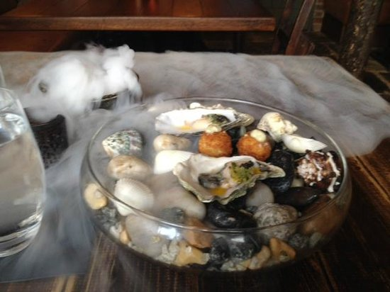 House of Tides: Oyster and fish cake on dry ice