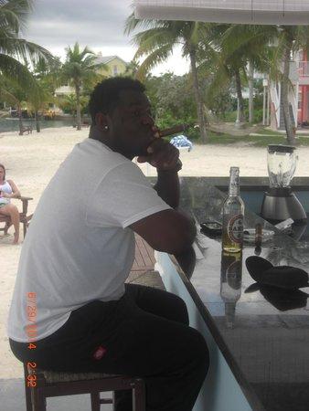Sandyport Beach Resort: My brother Cleveland working hard...lol