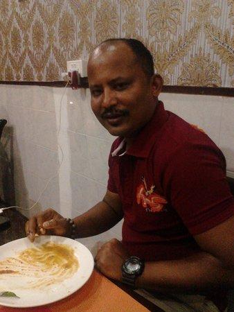 Taste Budz : My friend @ tastebudz enjoying the dosa and parrata ( kerala special)