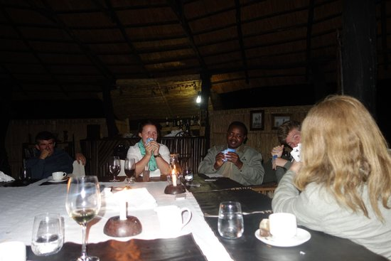 Mchenja Bush Camp - Norman Carr Safaris: Cards after dinner- such good fun!
