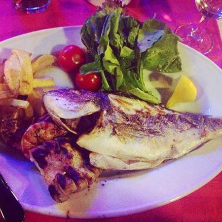 Our House Restaurant: My mixed seafood grill - seabass, langoustines and calamari YUMMY!