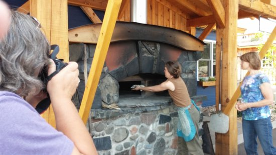 North House Folk School: Tossing Carta di Musica cracker bread into the wood-fired oven