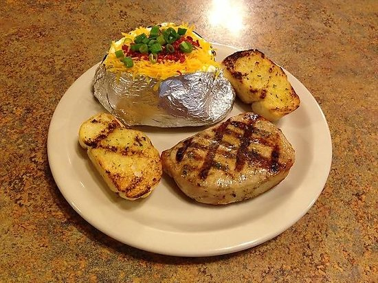Brewster S Restaurant Pork Chop Dinner With Loaded Baked Potato