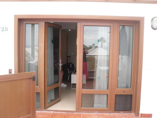 TUI Family Life Flamingo Beach Resort: Front doors/patio. We had french doors some apt have door
