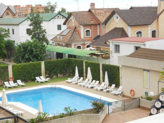 Hotel Macia Donana: Vista desde la habitación a piscina