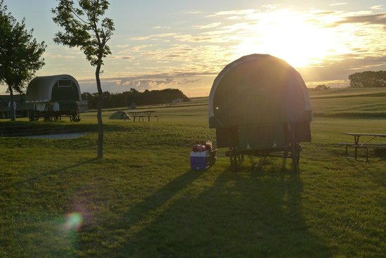 Ingalls Homestead - Laura's Living Prairie : The sun rising over the covered wagons.