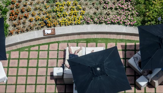 Hotel Arts Barcelona: If they run out of room at the pool chairs are set up in the garden, where you can still see the