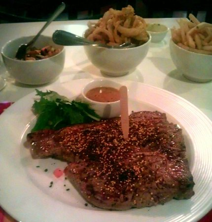 The Grillroom: T-bone steak with peppercorn rub & a generous side of onion rings.