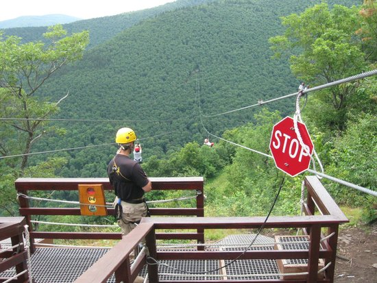 New York Zipline Adventure Tours: My wife and daughter taking off on the first zip line.