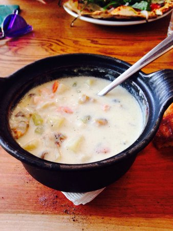 Morris East: Seafood chowder served on a wood board with corn bread