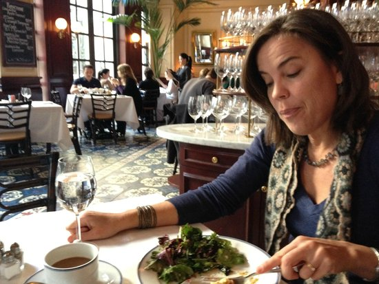 Bouchon : My wife, enjoying her quiche. Notice the environment. They also have outdoor seating.