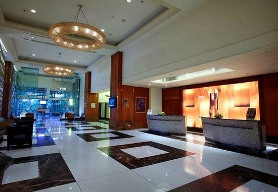 The hotel's official photo of their lobby. Garden Cafe is at the end on the right side...