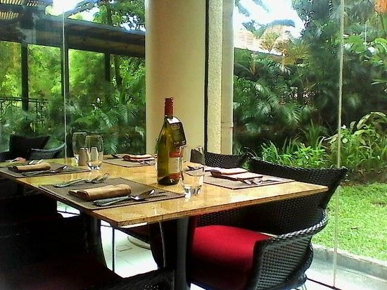 Garden Cafe : Table arrangement. Wine is ready if you like...
