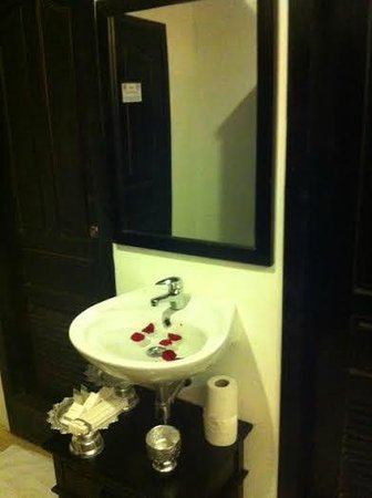 288 Boutique Hotel: Toilet room and shower room with a sink outside of both