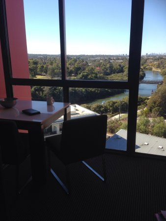 Meriton Suites George Street, Parramatta : Dining table and view