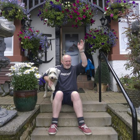 The Moorings: Andrew waving to a passing friend