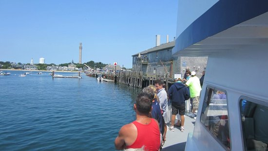 Plymouth to Provincetown  Express Ferry: The P-town ferry docking at Fishernam's Pier with the Pilgrim's Monument in the background.