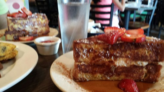 Sabrina's Cafe & Spencer's Too : Those two plates of french toast is just one order....huge servings ...had to split it!!!