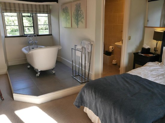 The Slaughters Country Inn: The bath in the bedroom and adjacent shower room