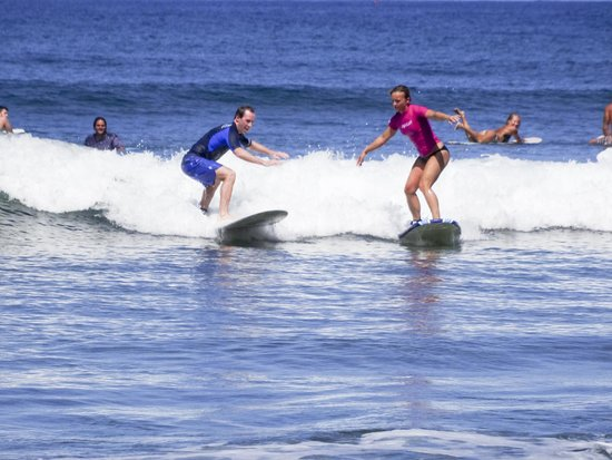 Rd.2 Happiness: Riding the same wave the morning after our wedding!