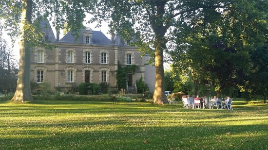 Chateau du Beugnon : view from pond area, the chairs are where we had aperitifs prior to dinner