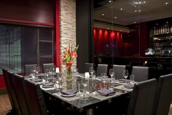 Red, The Steakhouse: Private VIP Room overlooking the bar.