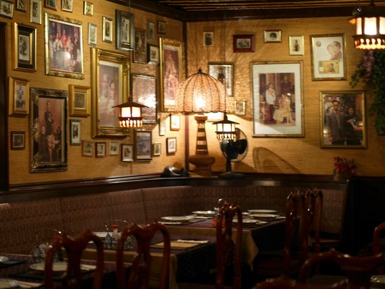 Siam : Vintage Thai interior, with photos of the king, elephant embroideries...