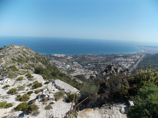 Teleferico Benalmadena: View from top of mountain, with safety rail in view.