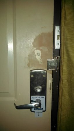 Days Inn Onley : Bedroom door to outside. Questionable hole filled in.