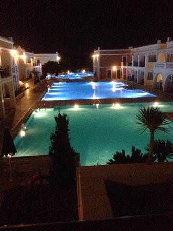 Atlantica Porto Bello Royal : Night time view of pools