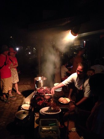 Naughty Nuri's Warung and Grill: Rib making in action