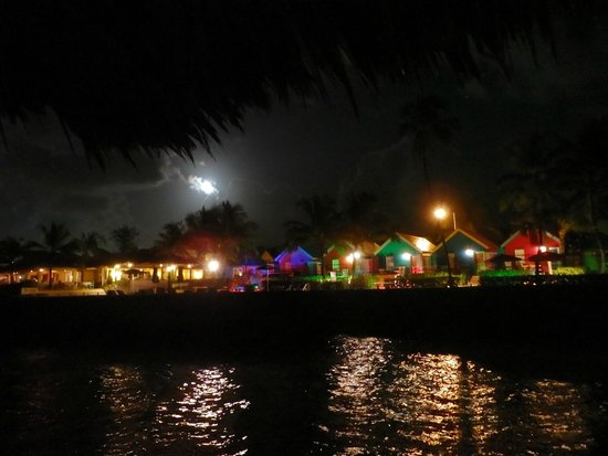 Compass Point Beach Resort: Hotel at night from the pier