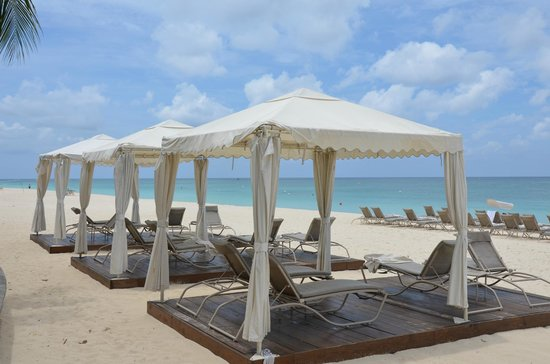 The Ritz-Carlton, Grand Cayman: Steps away from the pool are these cabanas and a beautiful beach.
