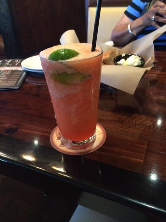 LongHorn Steakhouse : Sloppy frozen mango strawberry margarita .. It was delicious but sloppily made !