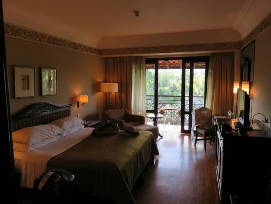 Sheraton Mustika Yogyakarta Resort and Spa: room,  view of garden, swimming pool and merapi mountain