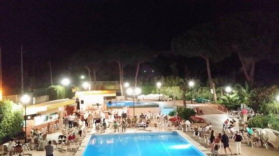 Hotel President: Pool at night.