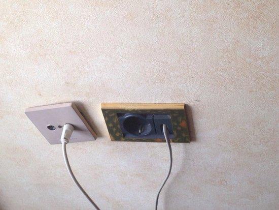 Rodos Palace: Broken sockets hanging off the wall