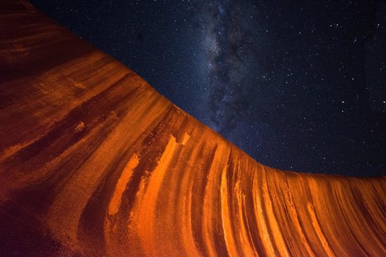 Wave rock with milky way