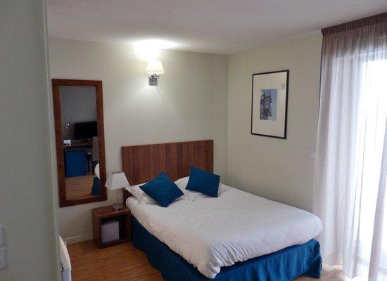 Appart'Hôtel Odalys Confluence : Le lit.