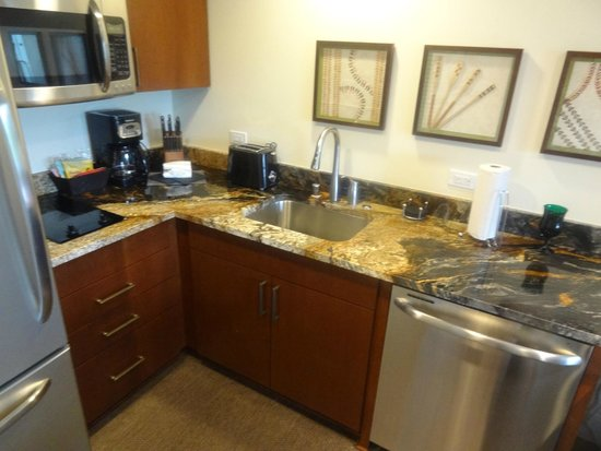 Kings' Land by Hilton Grand Vacations : Room's kitchen, complete with appliances, cookware, dishes, silverware, and basic cleaning suppl