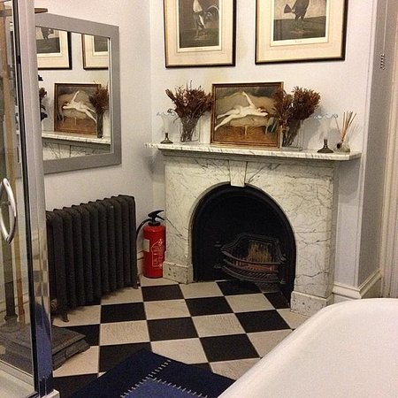 Anstey Hall: fire place in the bathroom
