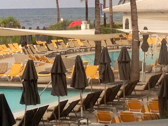 Boca Beach Club, A Waldorf Astoria Resort: Glimpse of two separate pools and ocean from 2nd floor SkyDeck as a storm is starting