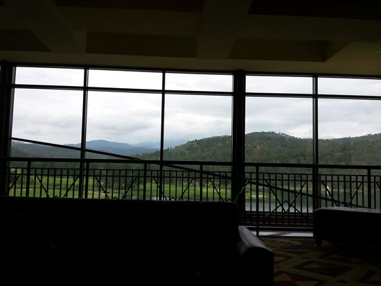 Inn of the Mountain Gods Resort & Casino : View from the main lobby over the lake & toward Sierra Blanca which is topped with clouds.
