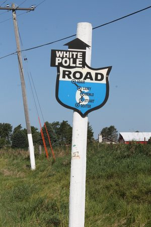 Stuart, IA: White Pole Road Sign, Dexter, Iowa