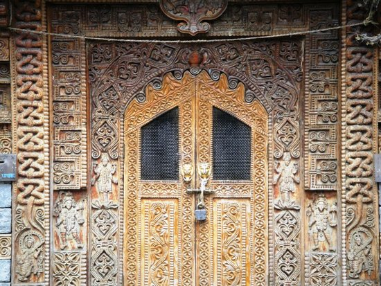 Naggar Castle : beautifully carved temple door and wall.
